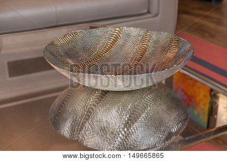 Glass and metal decorated bowl with gold and silver embelishments