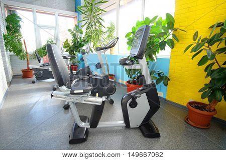 Interior of a fitness hall with sport bicycle