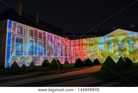 The Fine Arts museum of Chartres illuminated during Light scenographic show. Colorful light illumine historic places and some principal buildings throughout the event.