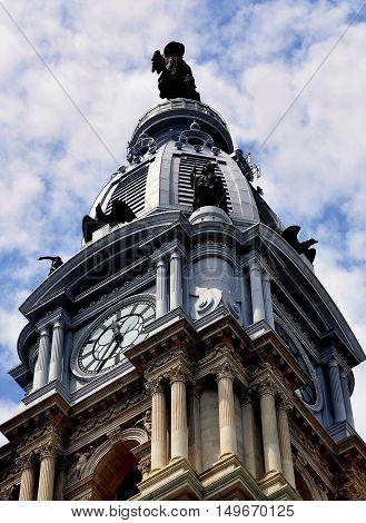 Philadelphia Pennsylvania - June 25 2013: 548 foot high tower topped by Alexander Milne Calder's statue of William Penn atop Philadelphia City Hall built between 1871-1901