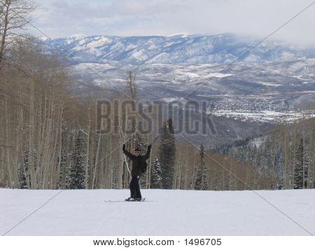 Man Lifting Ski Poles To Show Happiness While Skiing!