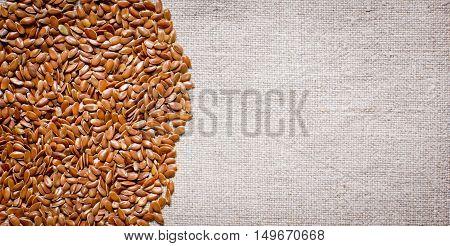 flax seeds on a fabric of flax fibers