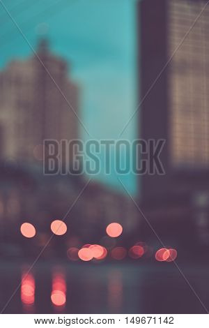 Blurred evening city lights out of focus background retro effect