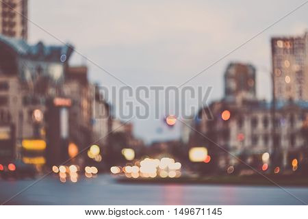 Blurred evening city street car lights background