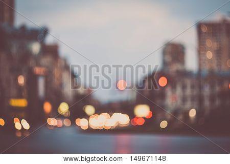Blurred evening city street lights background instagram effect