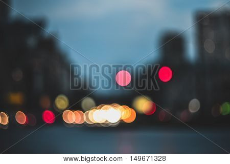 Blurred evening city lights out of focus background