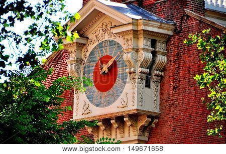 Philadelphia Pennsylvania - June 25 2013: An immense wooden clock stands on the south facade of 1732-53 Independence Hall