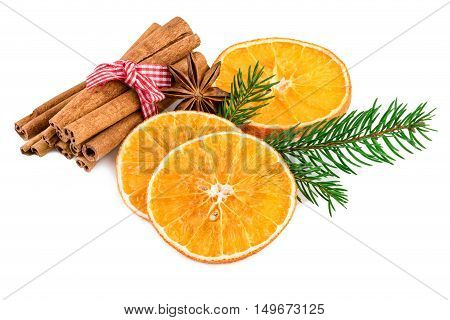 Christmas spices with cinnamon sticks and dried orange slices on white