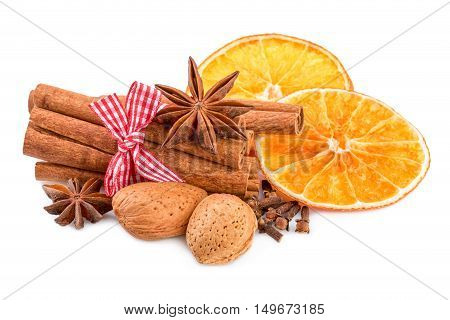 Christmas spices on white. Traditional christmas decoration with cinnamon anise and orange slices.