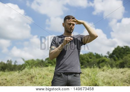 middle age man making yoga on grass