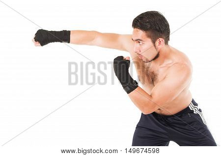 muscular martial arts fighter wearing black attacking isolated on white