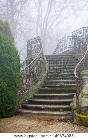 An foggy old stairway of a palace