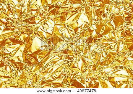 Shiny Yellow Gold Foil Texture For Background And Shadow. Crease.