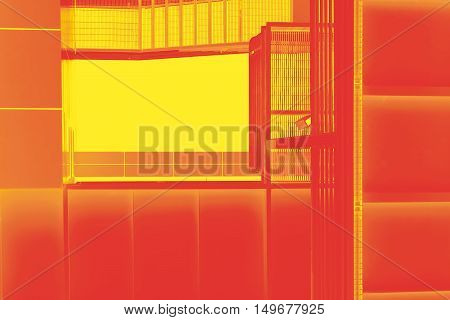 The bottom view of a conceptual and abstract colored fire escape.