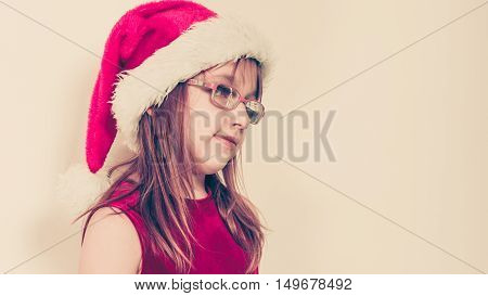 Little Girl Looking Like Santa Elf.