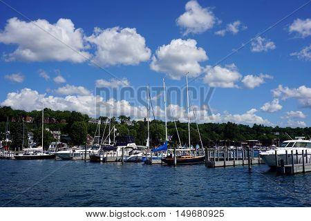 HARBOR SPRINGS, MICHIGAN / UNITED STATES - AUGUST 1, 2016: Sailboats and yachts are moored at the Harbor Springs Municipal Marina.