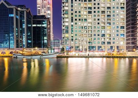 Riverside buildings in Canary Wharf at night
