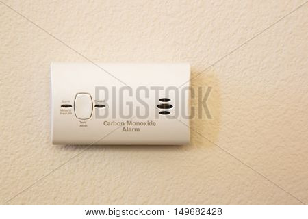 Carbon Monoxide Alarm Attached to Wall in House.