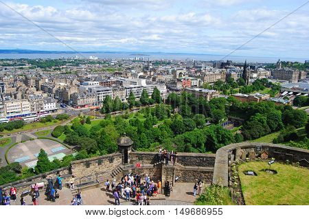 Edinburgh, United Kingdom - June 19, 2014. View over Edinburgh from the castle, with buildings, parks and people. The little garden in the bottom right corner is the cemetery for soldiers' dogs.