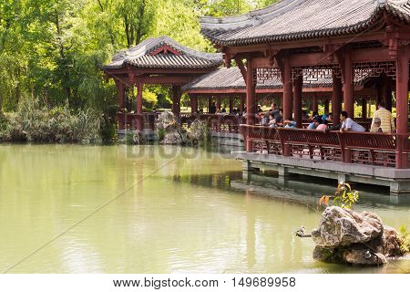Chengdu Sichuan province China - May 9 2016: People relaxing by a lake in the Wuhou area