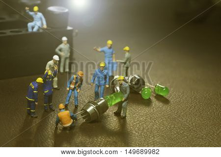 mini worker team working in manufacture and lens fare filter - can use to display or montage on products