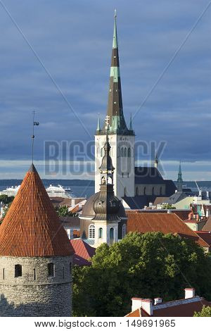 The spire of the Church of St. Olaf in close-up. Old Tallinn