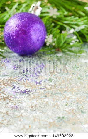 fir tree branch and Christmas toys bauble and snow flares confetti with copy space. Vertical orientation. Focus on foreground. Shallow DOF. Vertical orientation. Mock up for your design