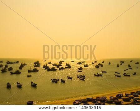 Fishing village in Mui Ne at sunset Vietnam Southeast Asia - blurred image