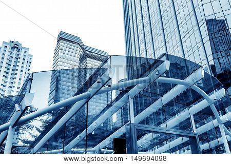 Through the glass ceiling, tall buildings. Guangzhou, China.