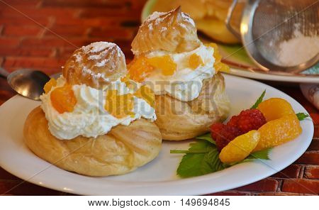 Two cream cake with raspberries and lemon