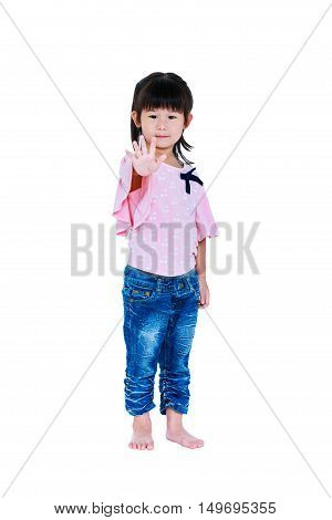 Full body of happy asian child posing in the studio isolated on white background. Playful girl showing stop gesture. Pretty child looking at her hand. Studio shot.