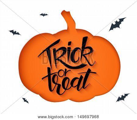 vector paper sheet with clipped pumpkin silhouette and hand lettering halloween greetings quote - trick or treat.