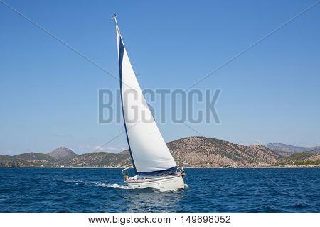 Boat in sailing regatta. Luxury yachts. Cruise yachting.