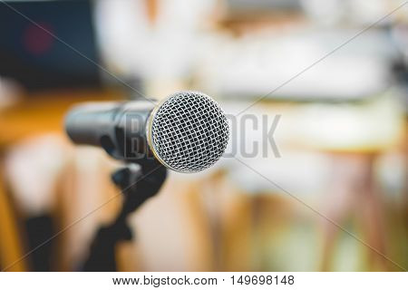 Close - Up Of Microphone In Conference Room Or Concert Hall With Blur Bokeh Background , Soft - Focu