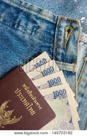 Thai Passport And Yen Money In Blue Jeans Pockets , Traveler Concept