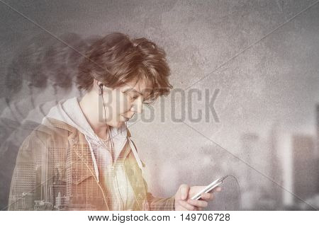 Double exposure of city and woman using earphones from smart phone listening to music.