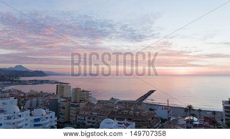 El Campello - October 3 2015: Early morning sunrise on ipanskom tourist Costa Blanca 3 October 2015 El Campello Costa Blanca Spain