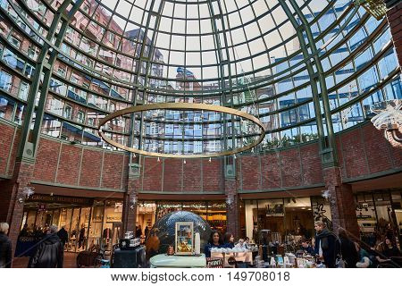 HAMBURG, GERMANY - MARCH 26, 2016: Shoppers stroll through Hanseviertel mall