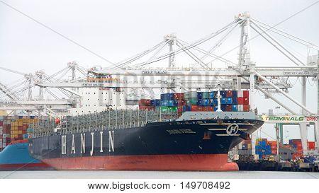 Oakland CA - September 29 2016: Cargo Ship HANJIN JUNGIL unloading at the Port of Oakland. Hanjin Shipping filed for bankruptcy protection Aug. 31 2016