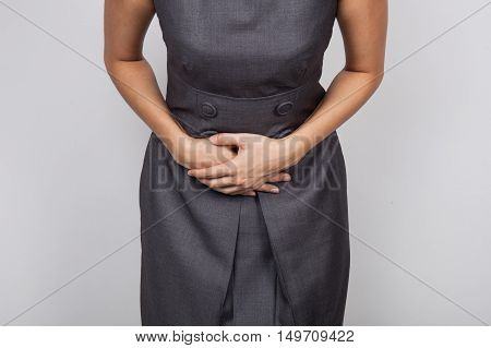 A Woman with haemorrhoids on a white background