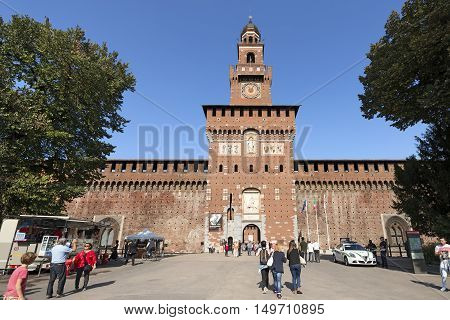 MILAN ITALY - SEPTEMBER 24 2016: People visiting the Sforza Castle XV century (Castello Sforzesco). It is one of the main symbols of the city of Milan Lombardy Italy