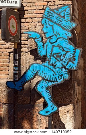 VERONA ITALY - SEPTEMBER 17 2016: Tocati International festival of street games. The logo of the Tocati festival (in Verona dialect it's your turn!) in a street of Verona Italy