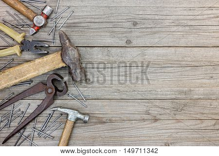 Tool Set Of Hammers, Pliers, Pincers And Nails On Grey Grunge Wooden Boards Background