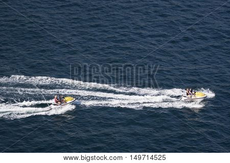 ACAPULCO MEXICO - FEBRUARY 19 2006: Two couples riding jet skis in the bay of Acapulco Mexico.