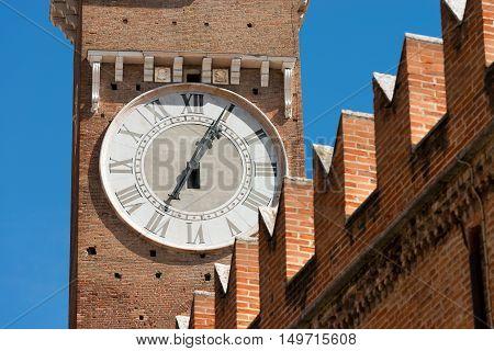 Detail of medieval clock tower of Lamberti (Torre dei Lamberti) (XI century - 84 m.) in Verona (UNESCO world heritage site) - Veneto Italy