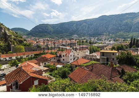 KOTOR MONTENEGRO - 12TH AUGUST 2016: A view of buildings in the direction of Old Town in Kotor during the day.