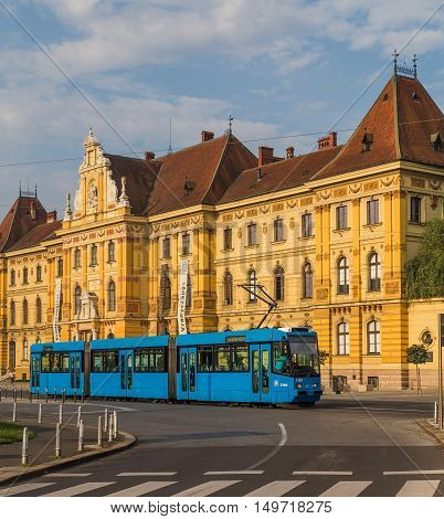 ZAGREB CROATIA - 17TH AUGUST 2016: A view of the Museum of Arts and Crafts and a common blue tram in Zagreb during the day.
