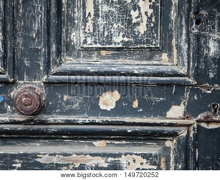 The Old Door with Cracked Paint Background closed with wood palets and vintage wall macro close up