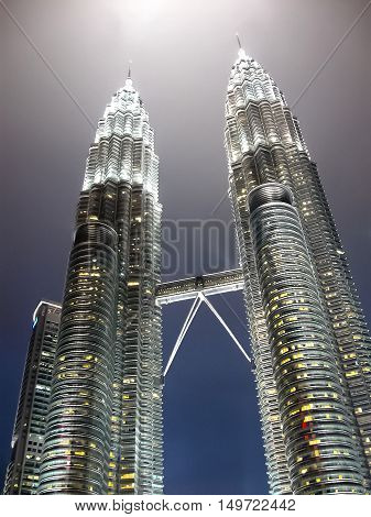 Kuala Lumpur - February 09 2011: Majestic view of Petronas Twin Towers at night in black and white. Petronas Twin Towers also known as KLCC is the tallest building in Malaysia.