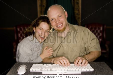 Man And Woman Enjoying Computer